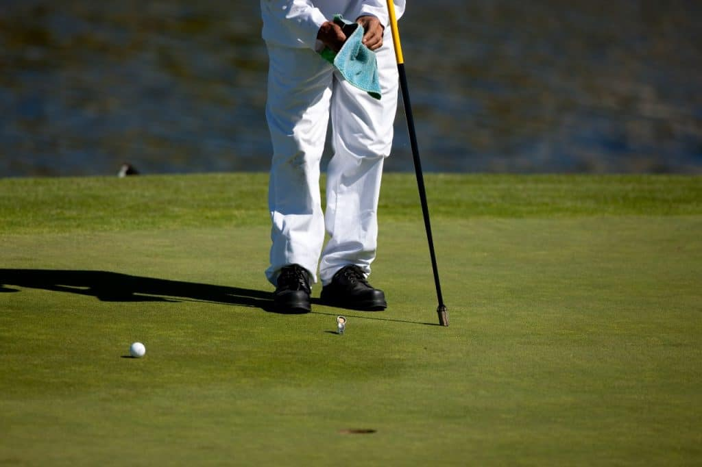 caddy using a golf towel